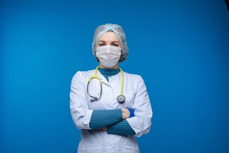 Lab worker or doctor with folded arms.