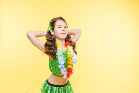 Lovely girl posing in bright dancing costume.