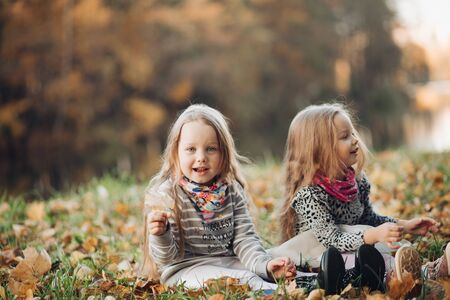 Cheerful little sisters rejoices with each other and laughs