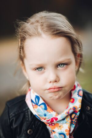 Portrait of beautiful girl in village is sad, picture isolated on blur background Banque d'images