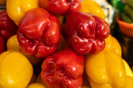 Close up of fresh peppers yellow and red lying on shelf in supermarket. Market and trade concept 版權商用圖片
