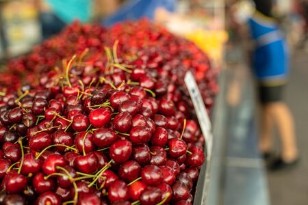 Close up of sweet cherry ready for sale at farmers market. Fresh fruits concept