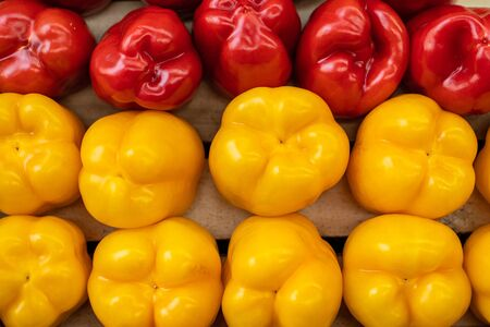 Close up of fresh peppers yellow and red lying on shelf in supermarket. Market and trade concept 版權商用圖片 - 150181957