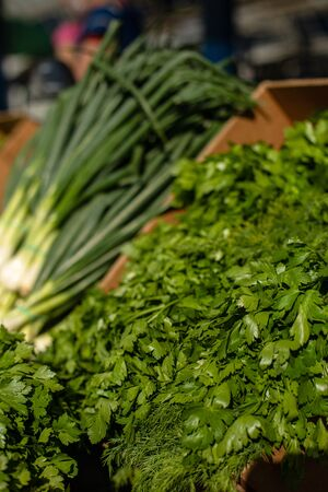 Picture of fresh greens, vegetables in a cardboard box at the market