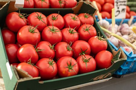Fresh ripe red tomatoes lying in the boxes in market 版權商用圖片
