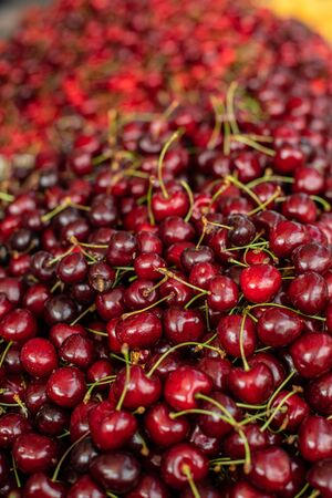 Close upu picture of a lot of burgundy, red cherries sold on the market. Fruit market 版權商用圖片 - 150419266
