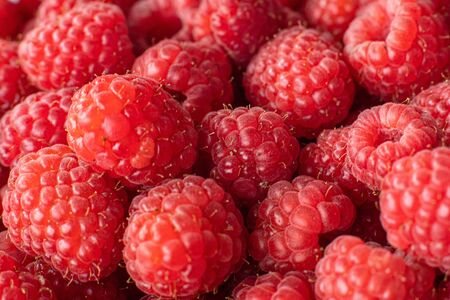 top view raspberry background, top view fresh raspberry. Juicy bright raspberries 版權商用圖片