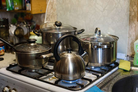 The kettle and pans are on the stove. Cooking in the kitchen 版權商用圖片