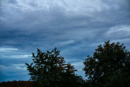 Beautiful dark evening sky with clouds in the village 版權商用圖片