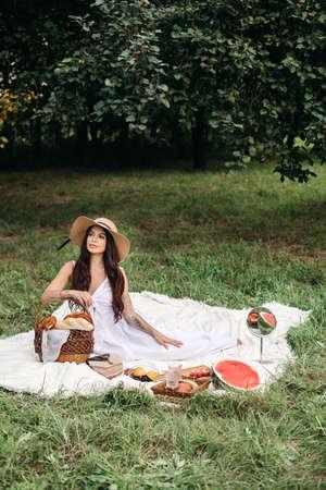 Beautiful Caucasian woman at picnic. Full length stock photo