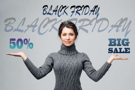 Young beautiful girl keeps the balance between discounts on the advertising banner