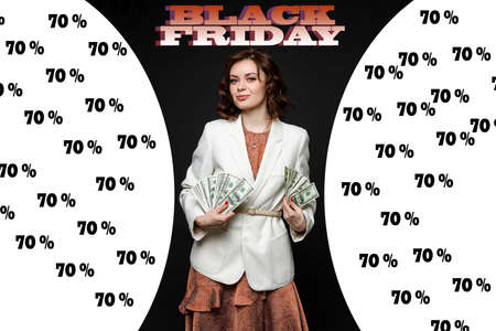 Beautiful rich woman poses against the background of discounts in the store during Black Friday 版權商用圖片