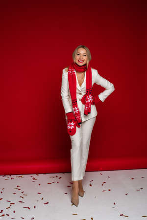 Christmas concept photo of elegant young woman in mittens