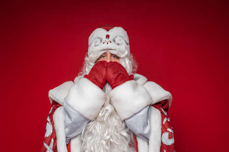 Father Frost covering mouth with both hands.