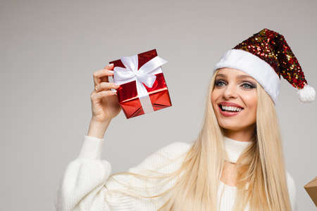 Happy young lady in Santa hat celebrating Christmas 스톡 콘텐츠