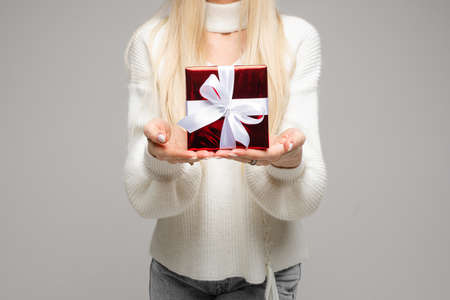Lady in white sweater demonstrating a New Year gift