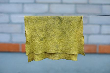 Dirty rag drying on a line. 版權商用圖片