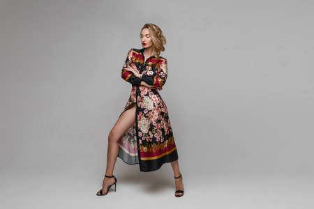 Fashionable model in trendy robe dress and heeled sandals. 版權商用圖片