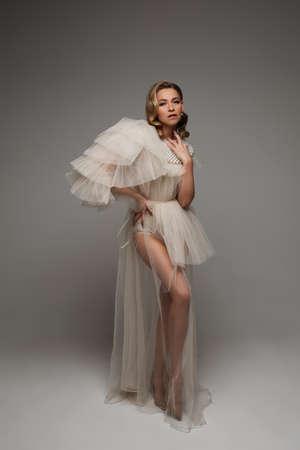 beautiful pregnant woman in long dress