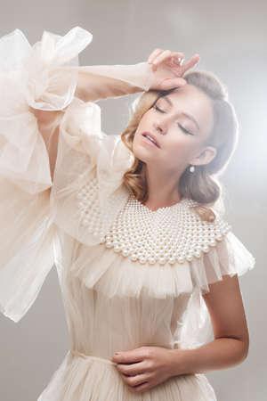Sensual woman in stylish high fashion dress with pearl beads. 版權商用圖片