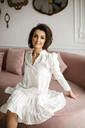 Gladsome Caucasian woman relaxing on the comfortable sofa