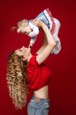 Excited loving mother having fun with her child