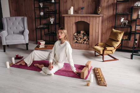 Young Caucasian woman practicing meditation at home