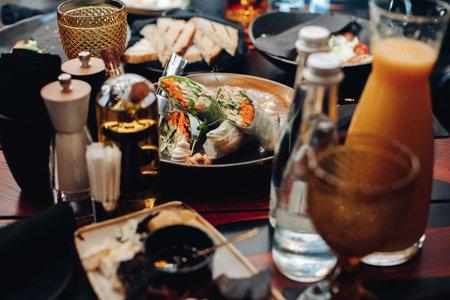 Veggie rolls in plate on served table. Stok Fotoğraf