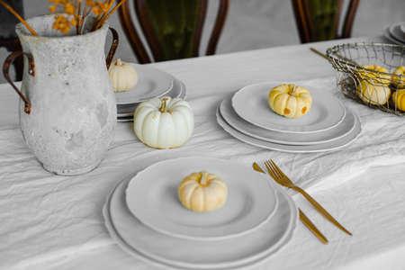 pumpkin cakes on the white plates for breakfast Stok Fotoğraf