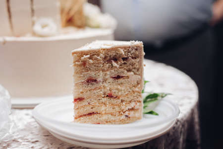a piece of a yummy cake on a plate in the kitchen