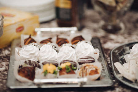 a lot of different cakes, cupcakes and other sweets