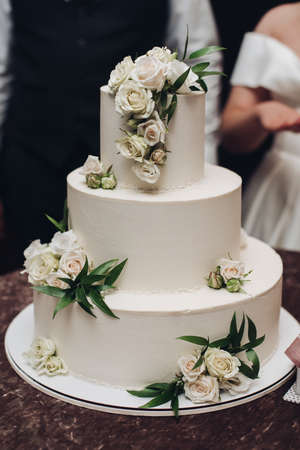 a big white cake with yummy flowers on it