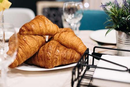 Tabletop photo of fresh crisp croissants displayed on plate Stok Fotoğraf