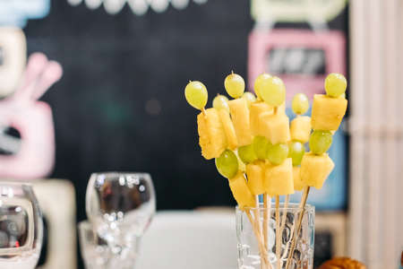 Catering, close up set of festive appetizing fruits canapes, healthy snacks on banquet, party dining Stok Fotoğraf