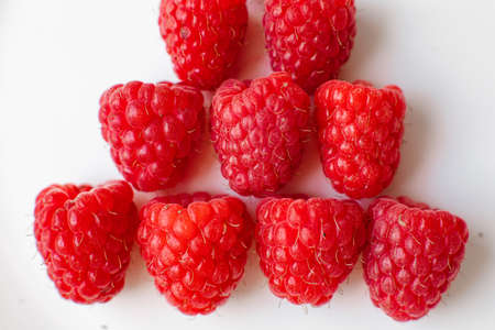 Collected raspberries on white background.