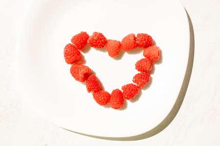 Raspberries in shape of heart.
