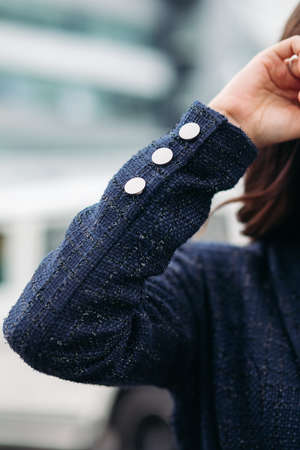 Cropped photo of stylish young woman outdoors
