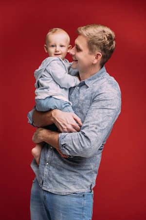 Loving dad with his son in arms.