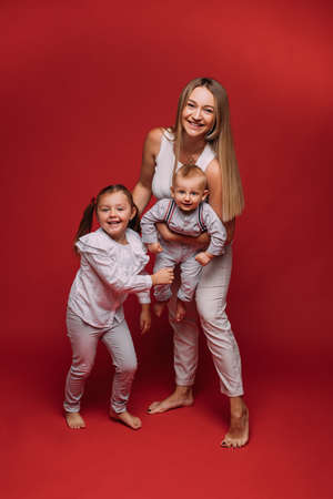 Happy mother with son and daughter.