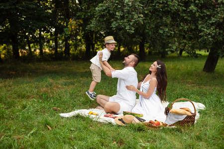 Happy family having picnic outdoors with their cute son Zdjęcie Seryjne