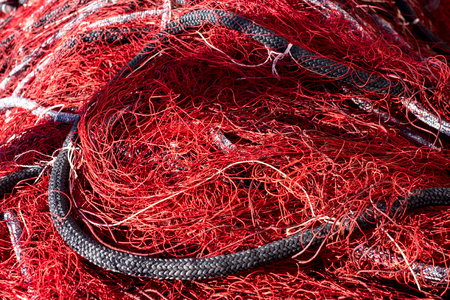 Red fishing net with ropes Stock Photo