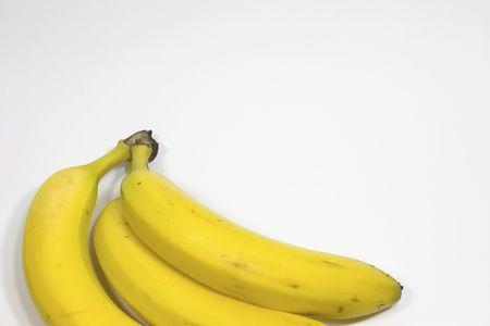 Three yellow bananas on white background