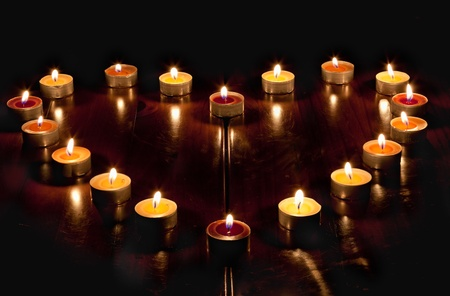 burning love: A heart of candles Stock Photo