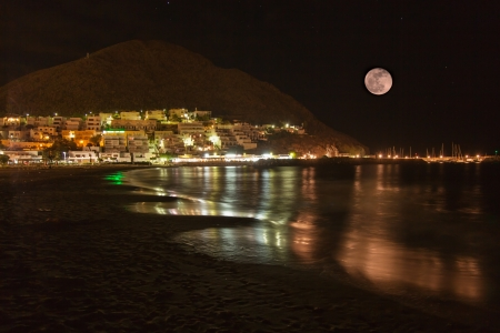 jose: Night photograph of the coast of San Jose whit a full moon Stock Photo