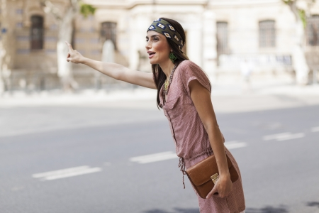 beautiful model with a headscarf calling a cab photo