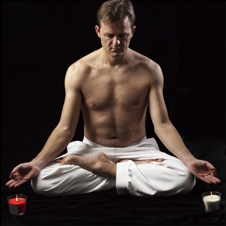 square portrait of an adult man in lotus position photo