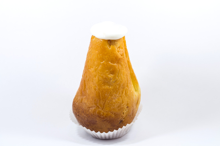 One yummy sugar rum baba isolated on a white background.