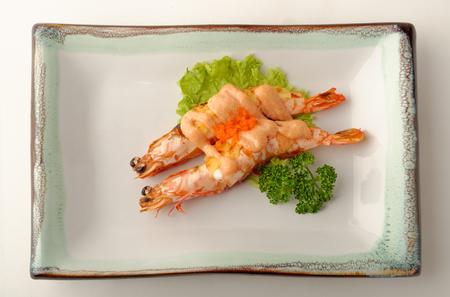 Grilled shrimp served on a glazed plate