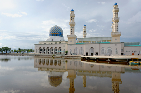 Mosque with reflection on water