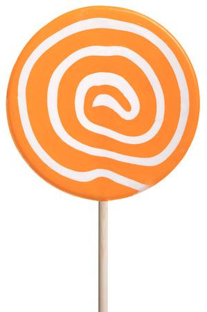 Round lollipop with orange and white swirls isolated on white. Zdjęcie Seryjne